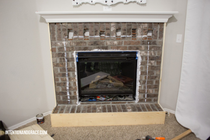 Cover fireplace with wood and marble