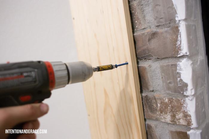 Drill into brick fireplace